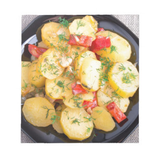 Top view on a stew of potatoes with pepper notepads
