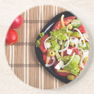 Top view on a vegetable salad with natural drink coasters
