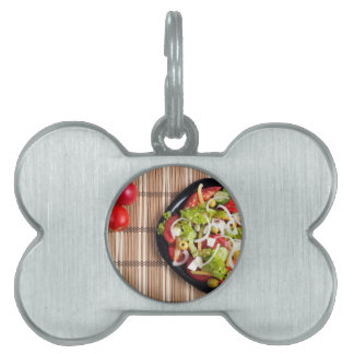 Top view on a vegetable salad with natural pet name tag
