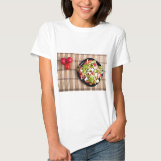Top view on a vegetable salad with natural t-shirts