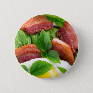 Top view on egg yolk, fried bacon and herbs 6 cm round badge