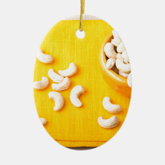 Top view on natural and healthy cashews ceramic oval decoration