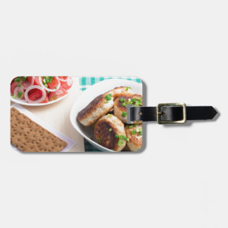 Top view on russian homemade lunch on a table luggage tag