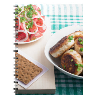 Top view on russian homemade lunch on a table notebook