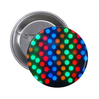 Top view on the blurred bright circles colored abs 6 cm round badge