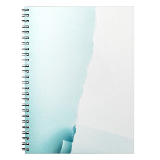 Torn colored paper notebooks