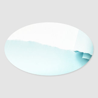 Torn colored paper oval sticker