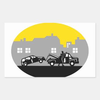 Tow Truck Towing Car Buildings Oval Woodcut Rectangular Sticker