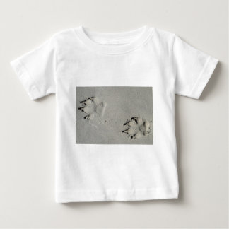 Tracks of a big dog on the sand baby T-Shirt