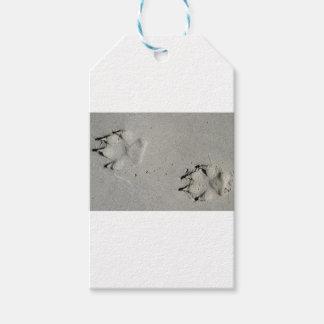 Tracks of a big dog on the sand gift tags