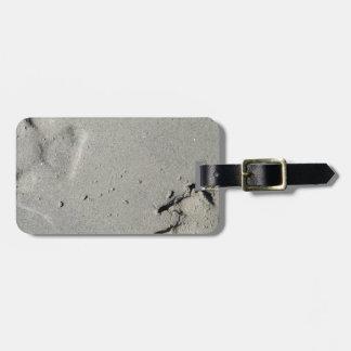 Tracks of a big dog on the sand luggage tag