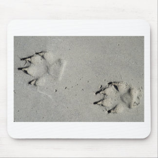 Tracks of a big dog on the sand mouse pad