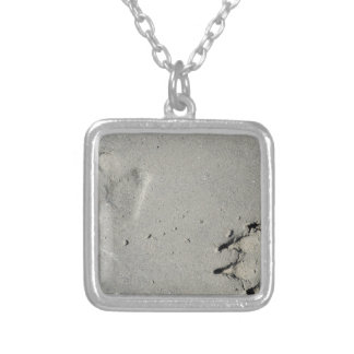 Tracks of a big dog on the sand silver plated necklace