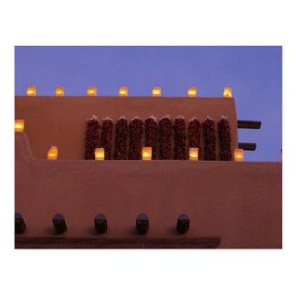 Traditional farolitos light up adobe structures 3 postcard