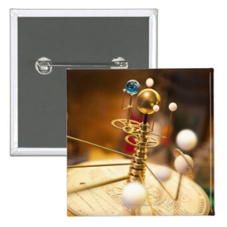 Traditional handcrafted brass orrery with the 15 cm square badge