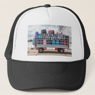 Trailer on airport filled with suitcases.JPG Trucker Hat