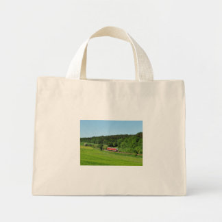 Tramcar with meadow field mini tote bag