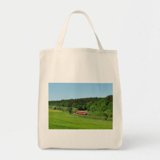 Tramcar with meadow field tote bag