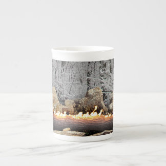 Tranquil Burning Yule Log in Snowy Forest Tea Cup