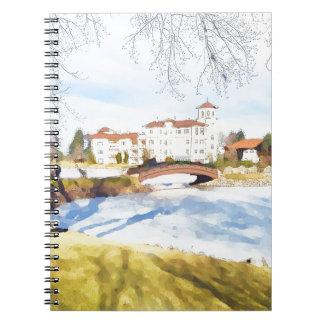 Tranquil hotel scene on lake notebooks