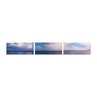 Tranquil Sea and White Clouds Canvas Print