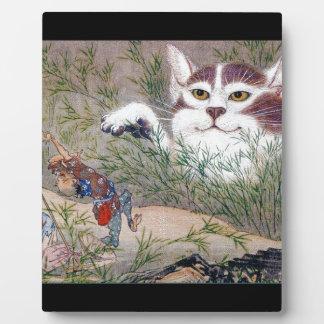 Transforming cat plaques