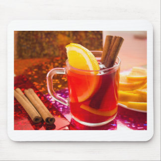 Transparent cup of tea with citrus and cinnamon mouse pad