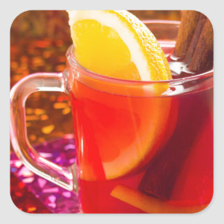 Transparent cup of tea with citrus and cinnamon square sticker