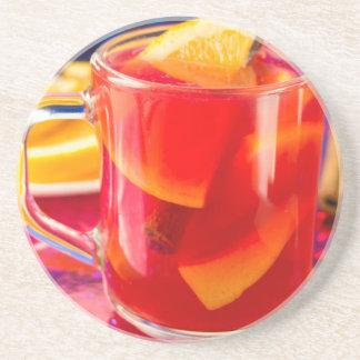 Transparent mug with citrus mulled wine coaster