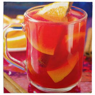 Transparent mug with citrus mulled wine napkin
