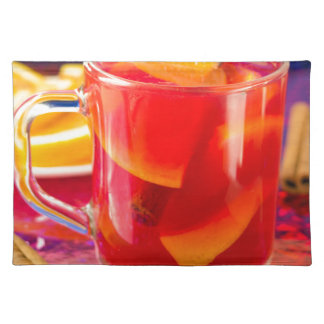 Transparent mug with citrus mulled wine placemat
