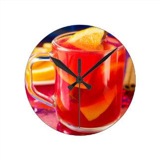 Transparent mug with citrus mulled wine round clock