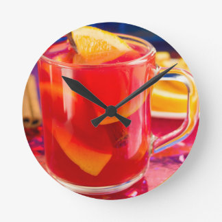 Transparent mug with citrus mulled wine round clock