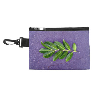 tree+branch,leaves,blue+sky,blue,sky,white+clouds, accessory bags