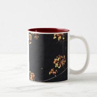 Tree buds against black background mug