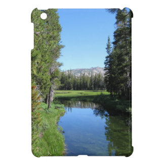 Tree-Lined River Meadow with Mountain Vista Photo iPad Mini Covers