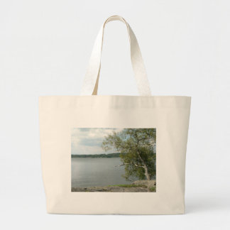 Tree On Lake Rock Shore Canvas Bags