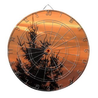 Tree silhouette with sunset dartboard