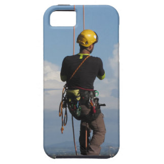 Tree surgeon lumberjack hanging from a big tree iPhone 5 covers