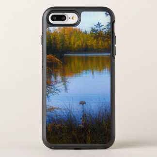 trees across a lake in fall phone case
