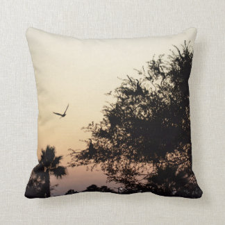trees and flying bird against florida sunset throw pillow