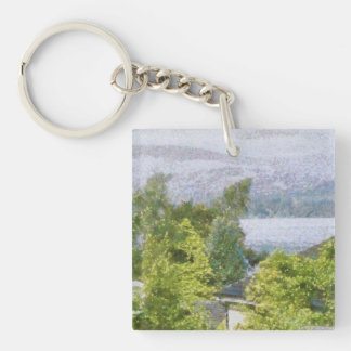 Trees and houses overlooking a lake key ring