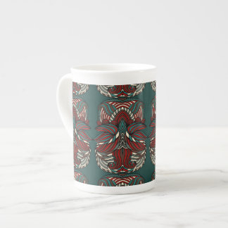 Trendy abstract tribal pattern.  Red and green. Tea Cup