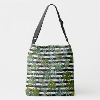 Trendy botanical leaf on stripes background crossbody bag