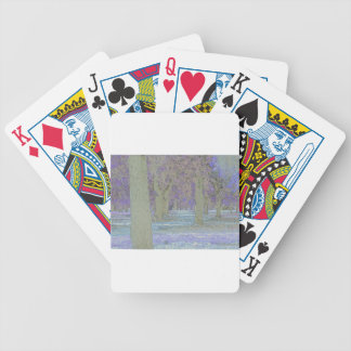 Tress in a park bicycle playing cards
