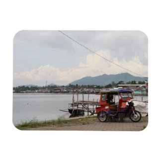 Tricycle on a quay rectangular photo magnet