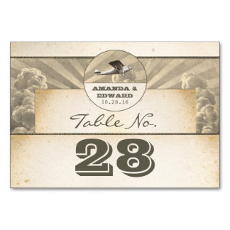 Tropical destination wedding place card with plane