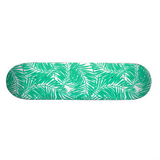Tropical green palm leaves skate boards