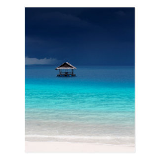 Tropical island white sand beach in paradise postcard