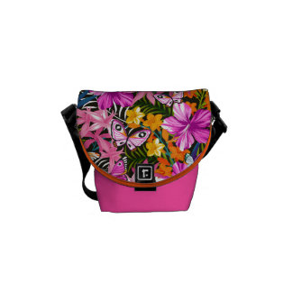 Tropical leaves and flowers messenger bags